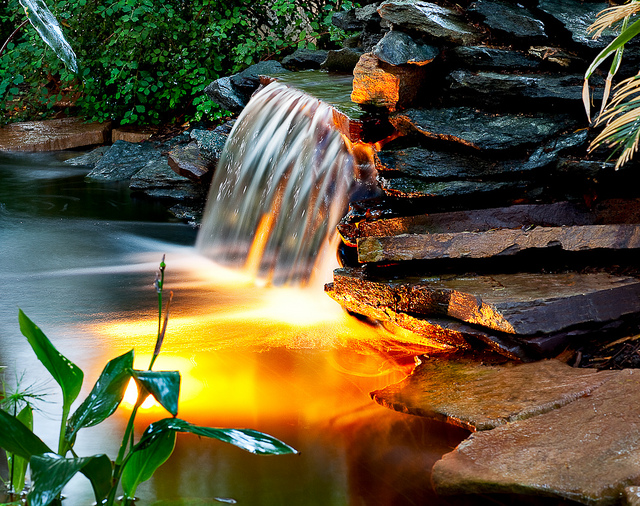 Koi ponds waterfalls water gardens pond boy water for Custom koi ponds
